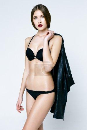 Caucasian beautiful woman in black underwear