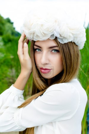 Beautiful woman in floral wreath