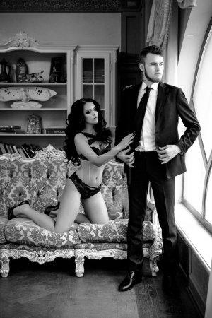Fashion photo romance of sexy lovers