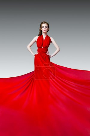 Photo for Fashion photo of young magnificent woman in red long dress, studio photo - Royalty Free Image