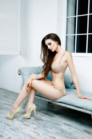Woman dressed in  lingerie