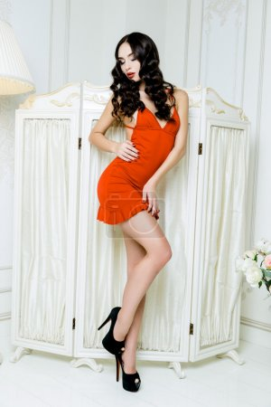 Model with long hair in red dress