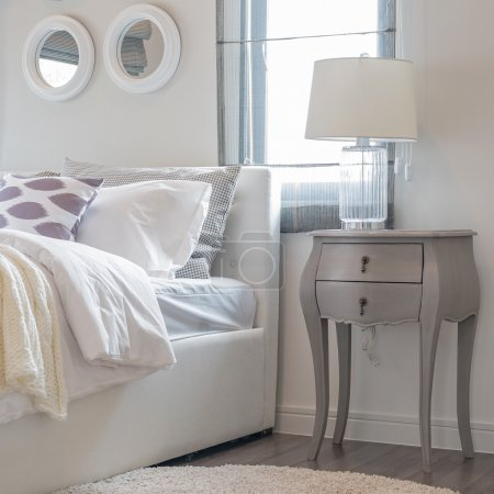 white lamp on classic table side in white bedroom