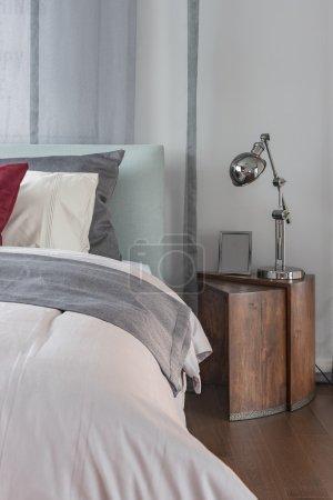 modern lamp on wooden table in modern bedroom