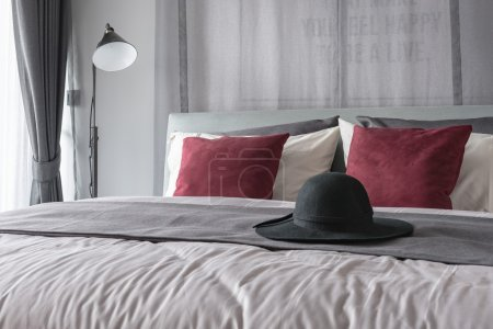 black hat on bed in modern bedroom design