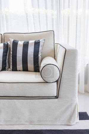 Photo for White elegance sofa with black and white pillows in luxury living room design - Royalty Free Image