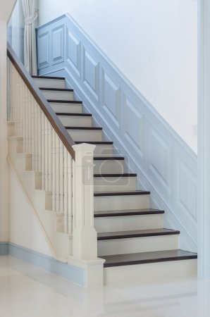 classic style wooden stair with white railing
