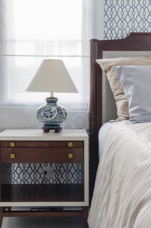 luxury bedroom with chinese style lamp on white table
