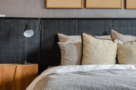 modern black lamp on wooden table in bedroom at home