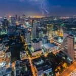 Bangkok cityscape with lightning at night...