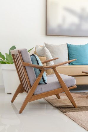 Wooden chair with pillow in modern living room