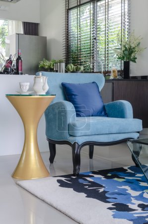 Pillows on blue sofa with lamp