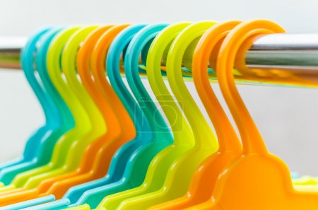 Photo for Set of colorful coat hanger hanging on rail - Royalty Free Image