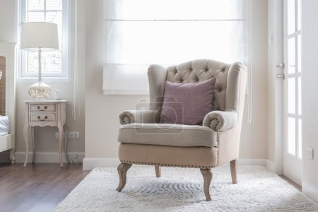classic chair on carpet with pillow