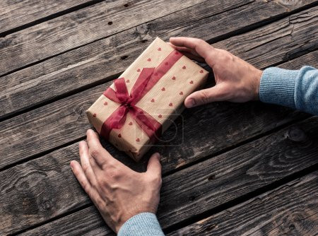 Photo for Gift box in male hands. Top view - Royalty Free Image