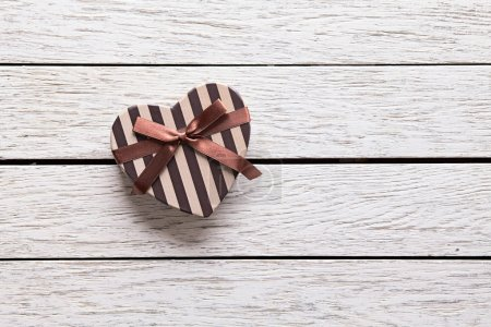 Photo for Heart shaped Valentines Day gift box on white wood. Holiday background. - Royalty Free Image