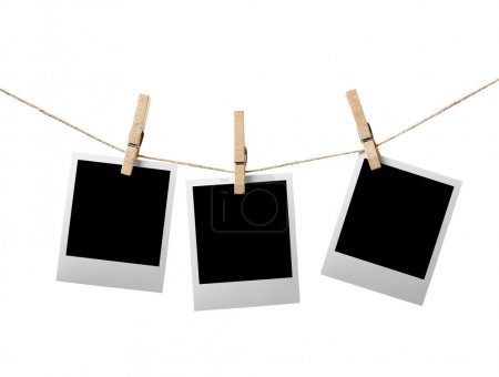 Photo for Three blank instant photos hanging on the clothesline. Isolated on white background. - Royalty Free Image