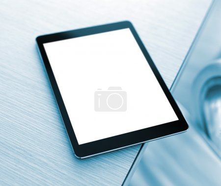 Photo for Digital tablet computer with isolated screen closeup on office desk - Royalty Free Image