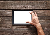 Using spread gesture on touch screen of digital tablet