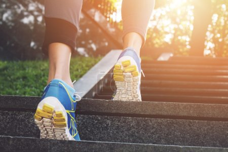 Photo for Athlete runner feet running in nature, closeup on shoe. Female athlete running on stairs. Woman fitness, running, jogging, sport, fitness, active lifestyle concept - Royalty Free Image
