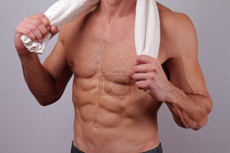 Close up of Strong muscular male torso showing six pack abs.  Bodybuilding, work out, sport, hard work, motivation, active lifestyle concept