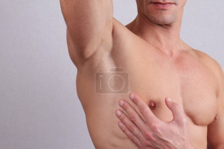 Photo for Close up of muscular male torso, chest and armpit hair removal. Male Waxing - Royalty Free Image