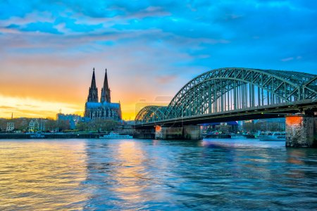Cologne Cathedral with Hohenzollern Bridge in Cologne, Germany