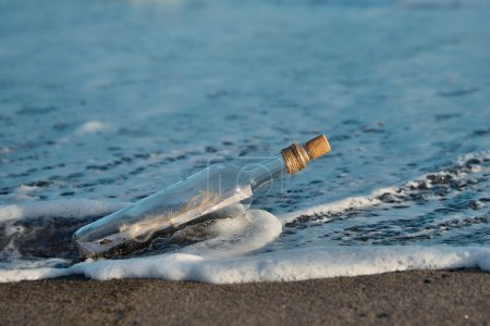 Photo for A Letter or message in a bottle on the shore,cast out by ocean or sea - Royalty Free Image