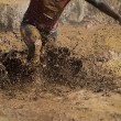 Mud race runners extreme sport....