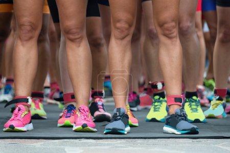 Athletes waiting at marathon start line