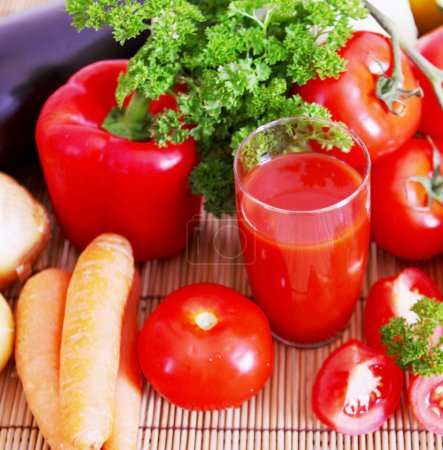 Photo for Fresh tomato juice in glass and tomatoes. - Royalty Free Image