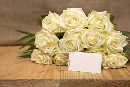 White roses bouquet.Wedding card.