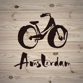 Watercolor design with bike and Amsterdam inscription on wooden background