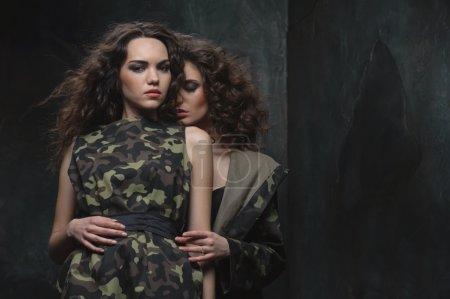 couple of models in khaki uniform