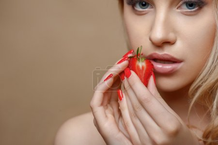 Beautiful healthy girl with red sweet fruit