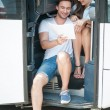 Cute loving couple is planning a route of their jo...