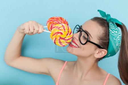 Beautiful young hipster girl is enjoying sweet food