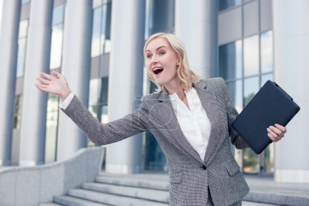 Cheerful young woman is greeting her business partner