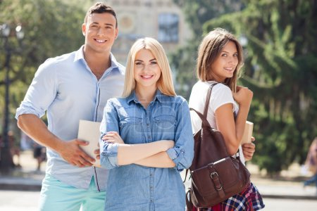 Attractive young friends are going to university