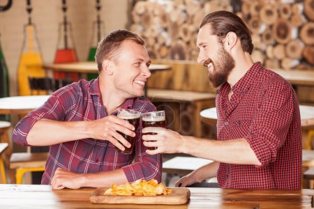 Attractive two men are spending time in bar