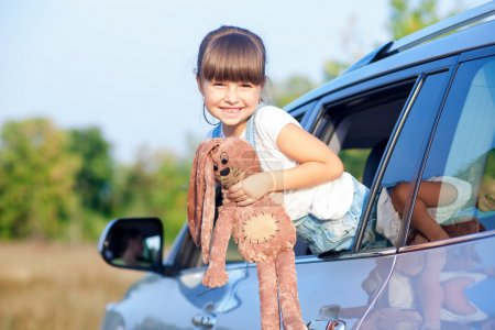 Pretty female child is playing in transport