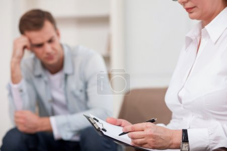 Skilful female psychologist is consulting her patient
