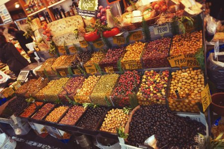 ISTANBUL, TURKEY - APRIL 15, 2015 : Rich assortment of pickled olives in the grocery market in Istanbul