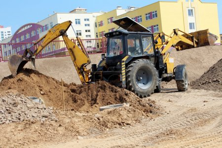 Photo for Yellow excavator during construction and landscaping. - Royalty Free Image