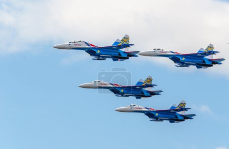 Flight groups of four su-27 aircraft from the aerobatic team Russian Knights at an Airshow in St. Petersburg. July 2015.