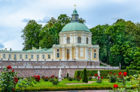 The Church Palace in Oranienbaum on the background of the Park and flower beds