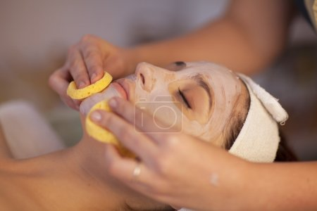 cosmetician removing mask