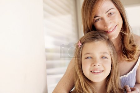 Mother hugging with daughter