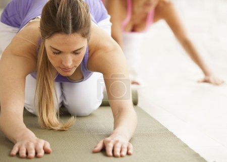 fit women doing yoga
