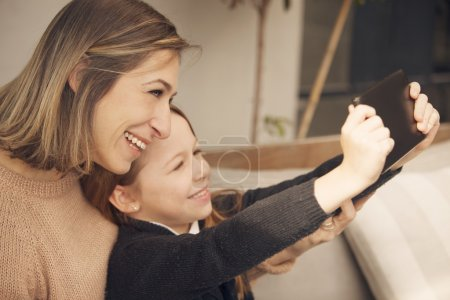 woman and girl making selfie